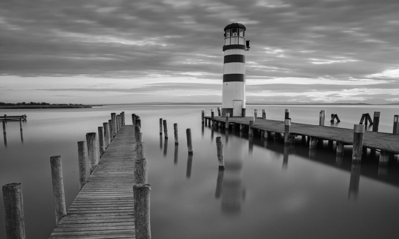 Beautifully Still-water with small Lighthouse Wallpaper Mural