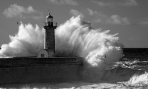 Lighthouse being Swamped by the Sea Wallpaper Mural